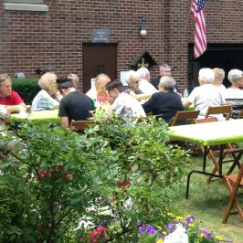 Fr Mike enjoying time with parishioners