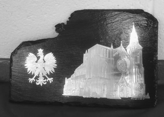 Image of Polish Eagle and St John Kanty Church on slate