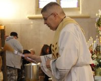 Fr Mike blessing Easter foods of the many who came for the 1 o'clock and 2 o'clock blessing