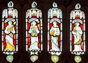 Stained glass depicting the Four Cardinal Virtues: Prudence. Temperance. Fortitude and Justice