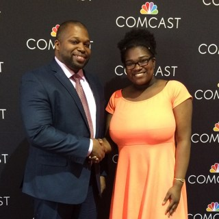 SMPA graduate Judith Suffard is presented The Comcast Leaders and Achievers Scholarship by Senator Gary Winfield