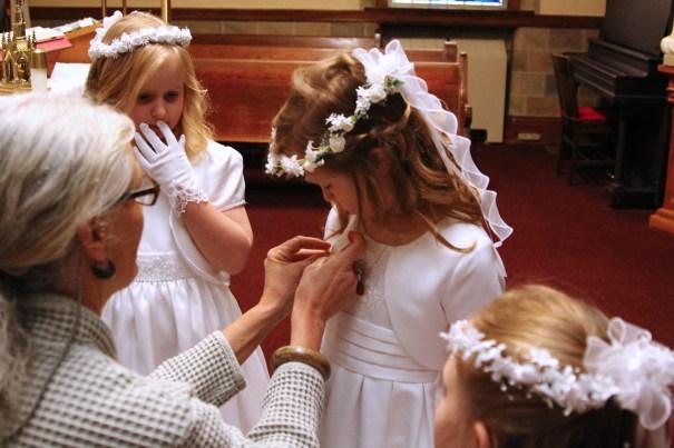 Mrs Haynes helps the girls get ready