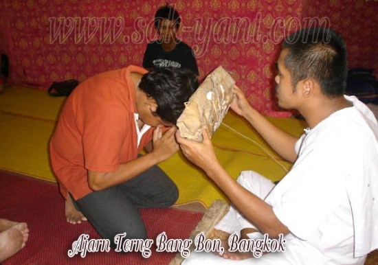 Sak yant office of Ajarn terng ???????? ?????????? ?????? 3 In this pic Ajarn terng uses a tiger's skin from Hlwong Por Derm to bless his devotees with.