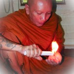 Luang Por Chanai performs Kasina Magic using a candle.