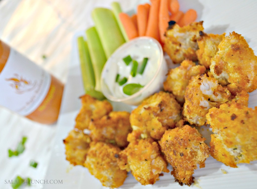 Vegan Buffalo Cauliflower Bites - These oven baked Vegan Buffalo Cauliflower Bites are a real crowd pleaser! Tender morsels of cauliflower baked in a crispy crust and then loaded with buffalo sauce! If you like wings, you love this leaner tastier snack! #gameday #recipe #superbowlsnack