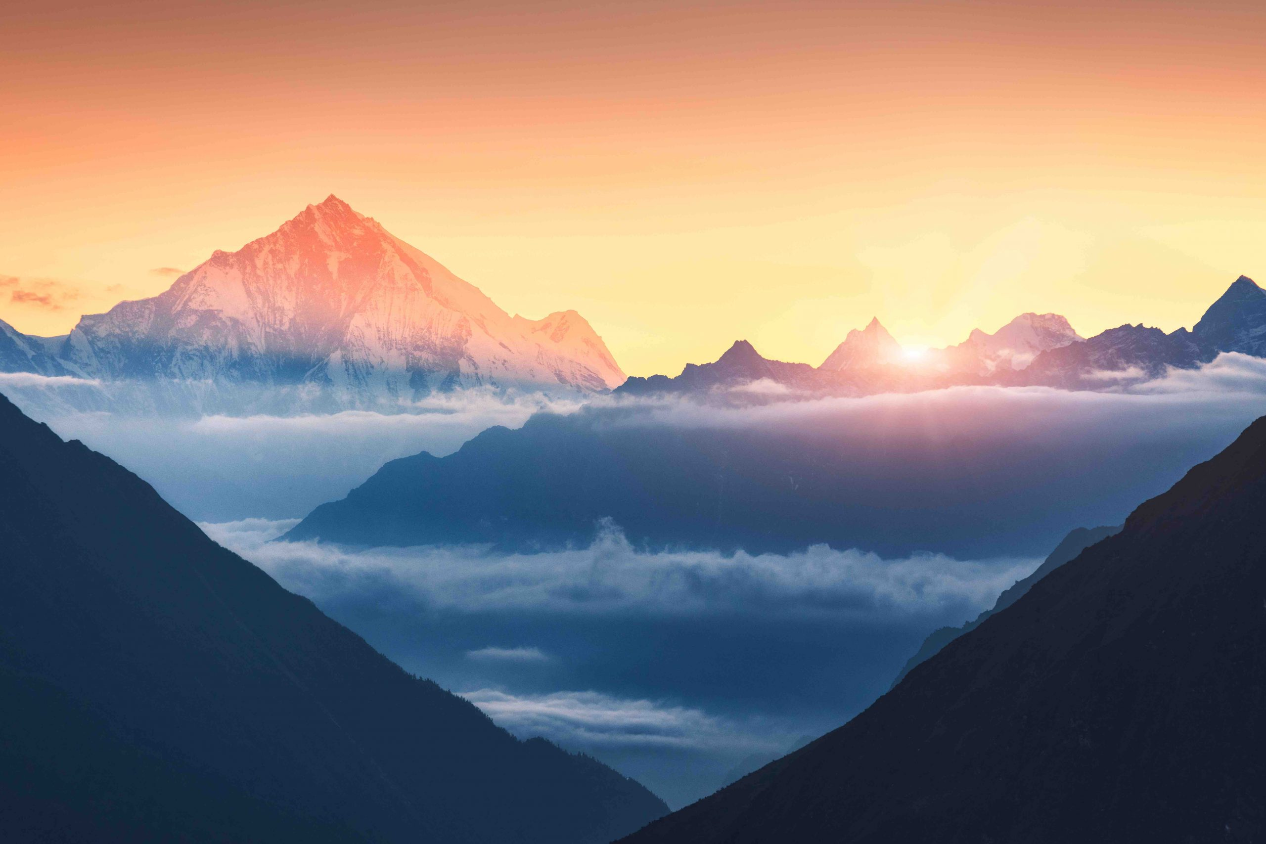 Mountains and low clouds at sunrise in Nepal
