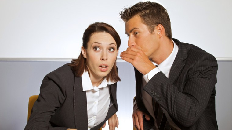 Businessman Whispering to Businesswoman Gossip Free Workplace