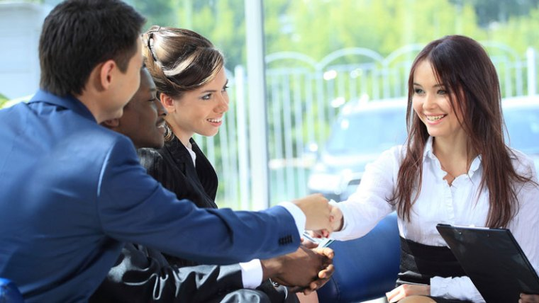 Stop Networking Start Making Relationships Business Woman shaking hands with others