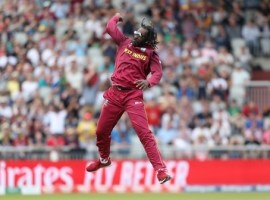 West Indies Chris Gayle celebrates taking the wicket of New Zealand's Ross Taylor during the ICC Cricket World Cup group stage match at Old Trafford, Manchester.