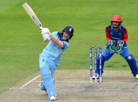 England's captain Eoin Morgan hits a six during the ICC Cricket World Cup group stage match at Old Trafford, Manchester.