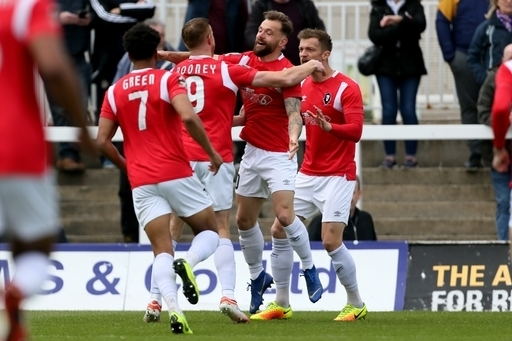 Salford City's Adam Rooney is congratulated by Salford City's Danny Lloyd after opening the scoring during the Vanarama National League match at the Super 6 Stadium, Hartlepool.
