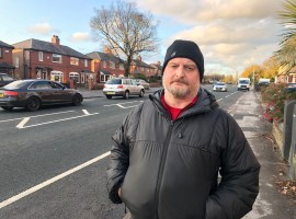 Image by Holly Pritchard. Paul Brighouse stood at the proposed bus lane site on the A666 Bolton Road.