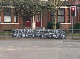 Banner outside of Manchester Royal Infirmary showing solidarity. Image credits: Holly Pritchard 2020
