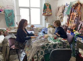 Pupils working on up cycling their clothes.  Copyright: Zoe Bott