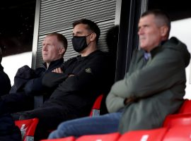 Salford City co-owners Paul Scholes (left) and Gary Neville (centre) with Roy Keane in the stands during the Sky Bet League Two match at The Peninsula Stadium, Salford. Credit: PA Images