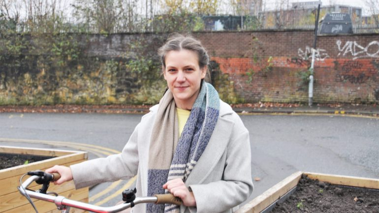 Harrie Larrington-Spencer with her bike. PhD researcher at the University of Salford