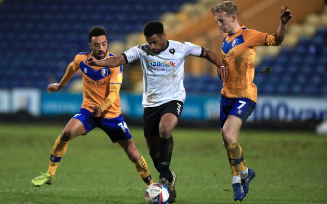 Mansfield Town's James Perch (left) and Harry Charsley (right) battle for the ball with Salford City's Ibou Touray (centre) during the Sky Bet League Two match at the One Call Stadium, Mansfield.