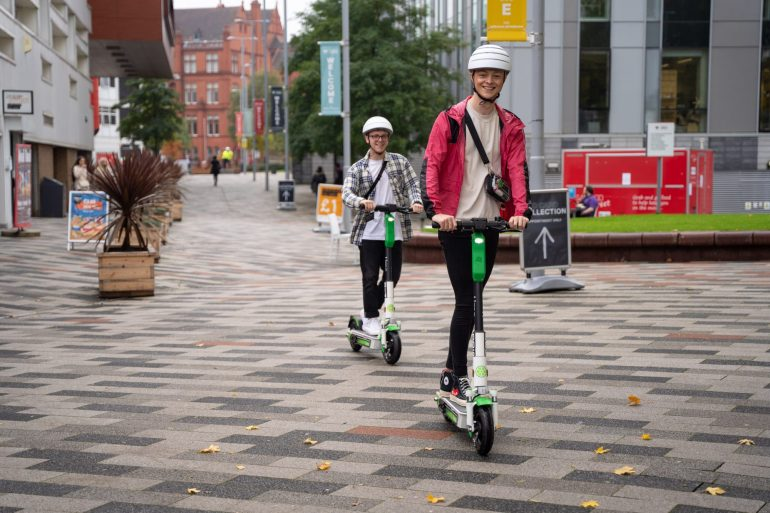 riding e-scooters in Salford