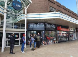Queues for haircuts at Salford Shopping City on Monday. Copyright Marcus Smith