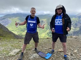 World's only extreme flipper walker completes hike up Mount Snowdon for charity