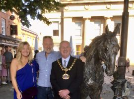 Emma Rogers next to her new sculpture. Image credit: Salford City Council