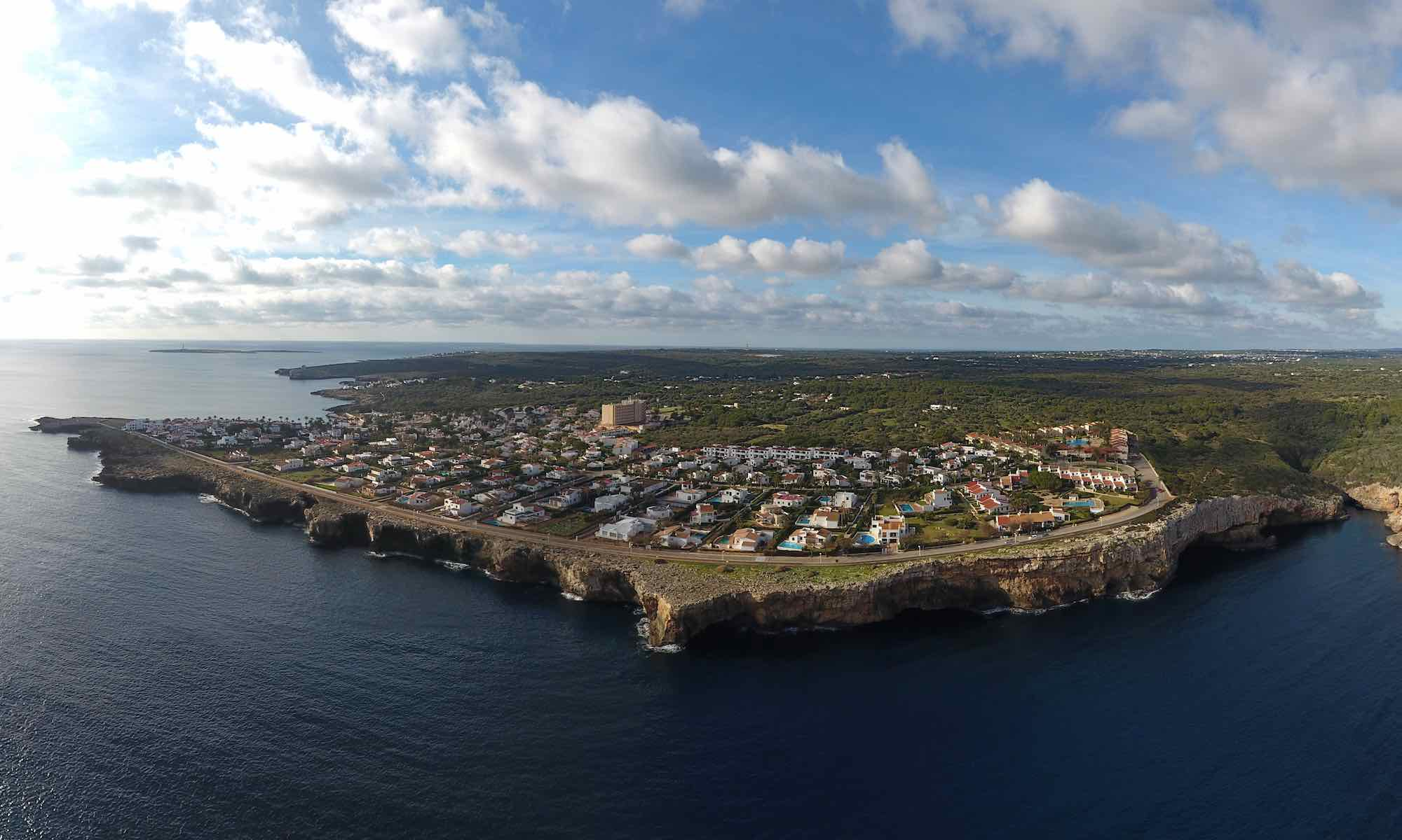 Aerial view of S'Algar in Menorca across the Marine Reserve Isla del Aire