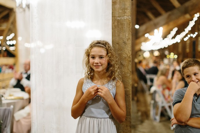 Young girl having a good time at a wedding