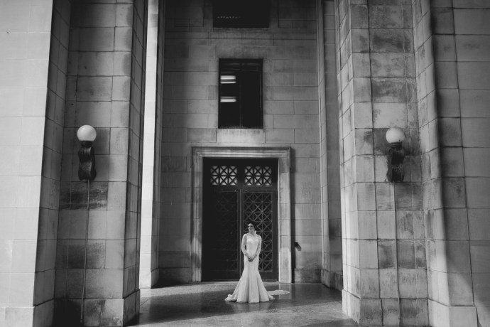 Beautiful woman stands in front of Legislative Plaza on her wedding day