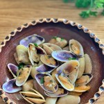 Fun beach activity transformed into a delicious appetizer: Tellin shells with garlic and parsley