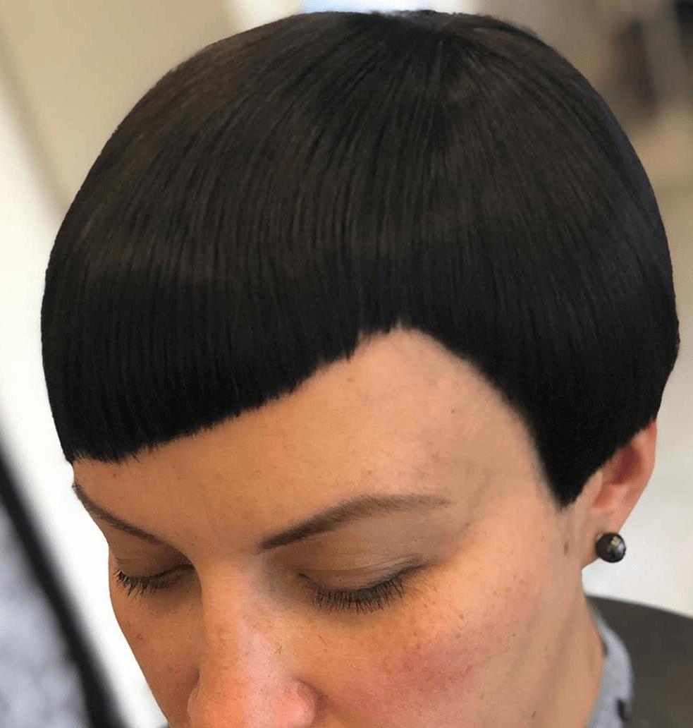 Woman with black asymmetrical bangs and a short haircut
