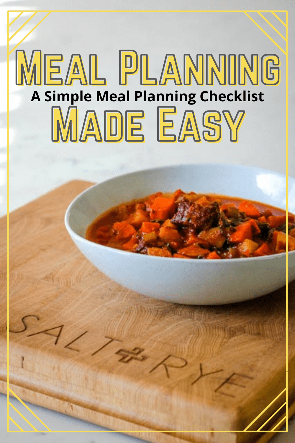 Bowl of my Beef and Tomato Soup on my branded cutting board. The post contains information about how I meal plan and some simple recipes!