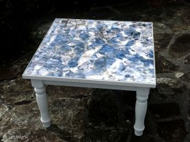 square coffee table featuring stream of light at Porth Nanven