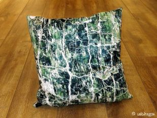 cushion featuring serpentine rock detail