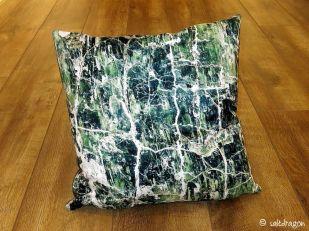 cushion featuring serpentine rock detail