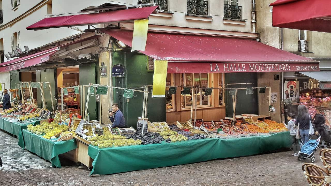 hidden treasures in paris: visit one of the pedestrian cobbled stoned street and discover hidden places in Paris and food paradise