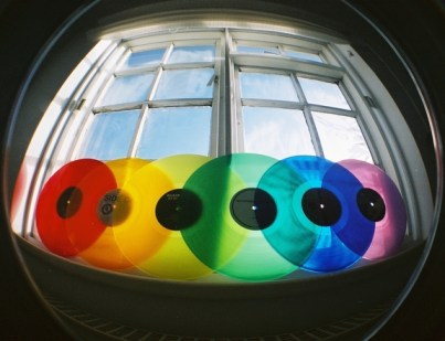 colored vinyl discs on window
