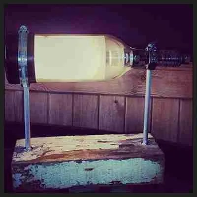 Wine bottle lamp-created-with-reclaimed-wood-and-industrial-fittings