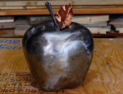 Steel apple with copper leaf