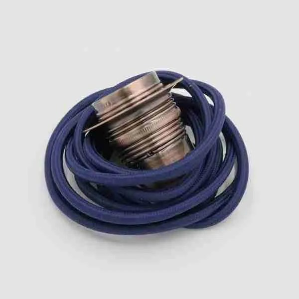 aged copper lighting accessory with navy blue cable