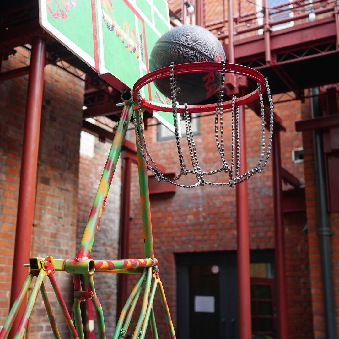 Basket ball hoop made from salvaged cycles