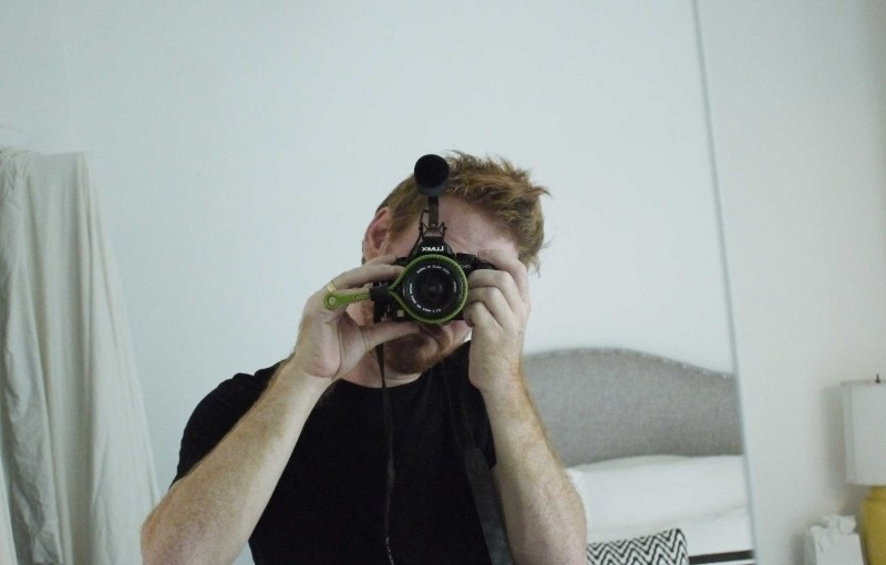 A photo of Sam Mallery with a camera