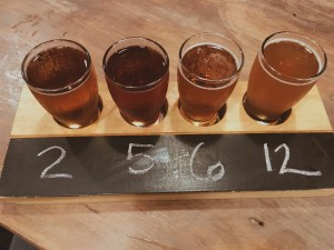 Flight of four beer samples at Shipyard Brewery