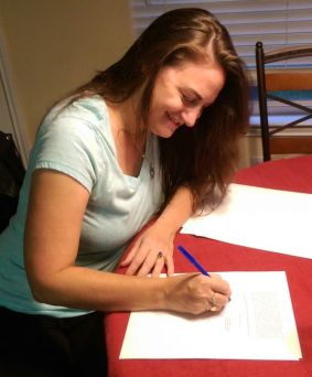 Samantha M Clark signing a contract with Simon & Schuster for THE BOY, THE BOAT, AND THE BEAST