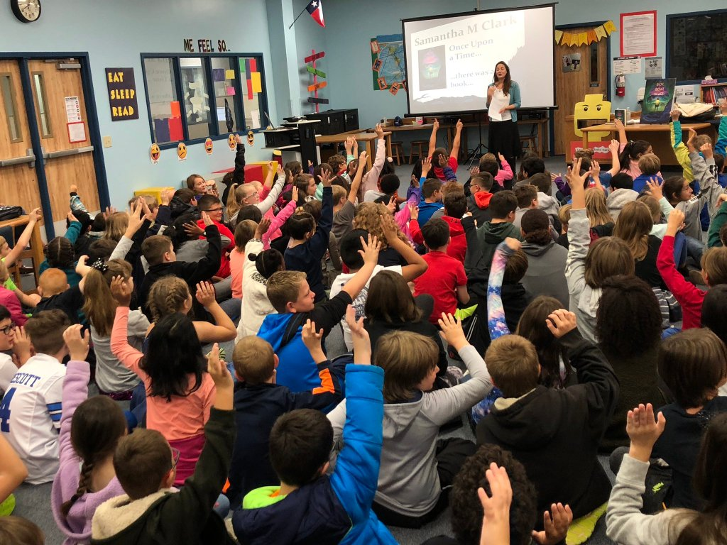 Faubion Elementary students ask Samantha M Clark questions.