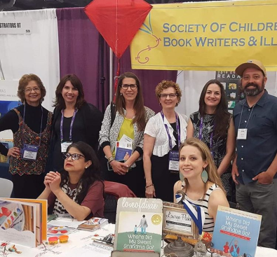 Me with a bunch of Austin SCBWI authors and illustrators at our booth at TLA 2019. So much fun.