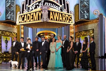 Missi Pyle on stage at 84th Academy Awards with 'The Artist' cast