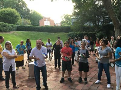 Students learn a basic rhythm on tamborim