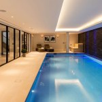Swimming pool with lighting by Sam Coles Lighting
