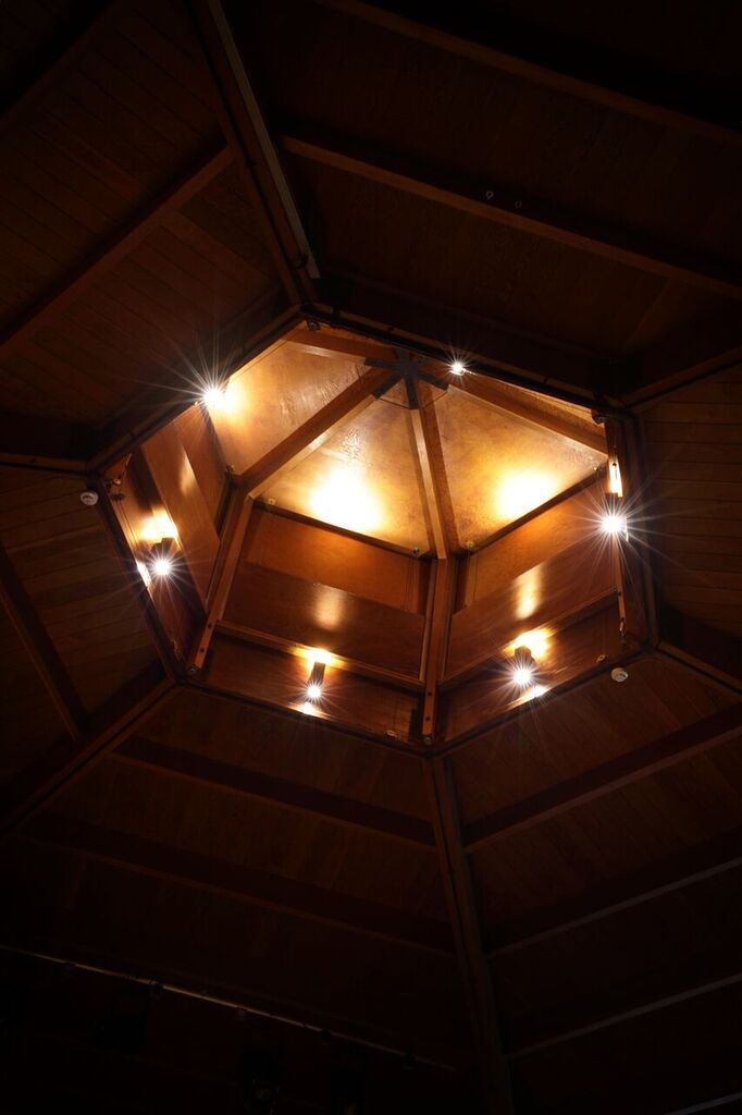 Gymnasium wooden roof withlighting by Sam Coles Lighting