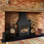 Fireplace lighting with wooden beams by Sam Coles Lighting 02